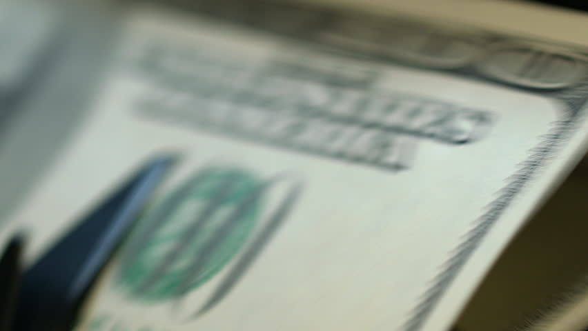 Cash counting machine calculating 100 dollar bills. Business accounting. Machine counting money. Credit and deposit financial operations. Close up of bank automatic equipment for counting cash money | Shutterstock HD Video #1011823781