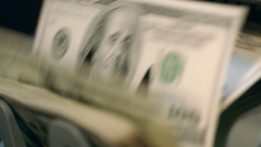 Money counting machine. Banknote counter counting hundred dollar bills. Banking and commercial activity. Automated bank equipment for counting paper currency. Automatic operations of cash | Shutterstock HD Video #1011823790