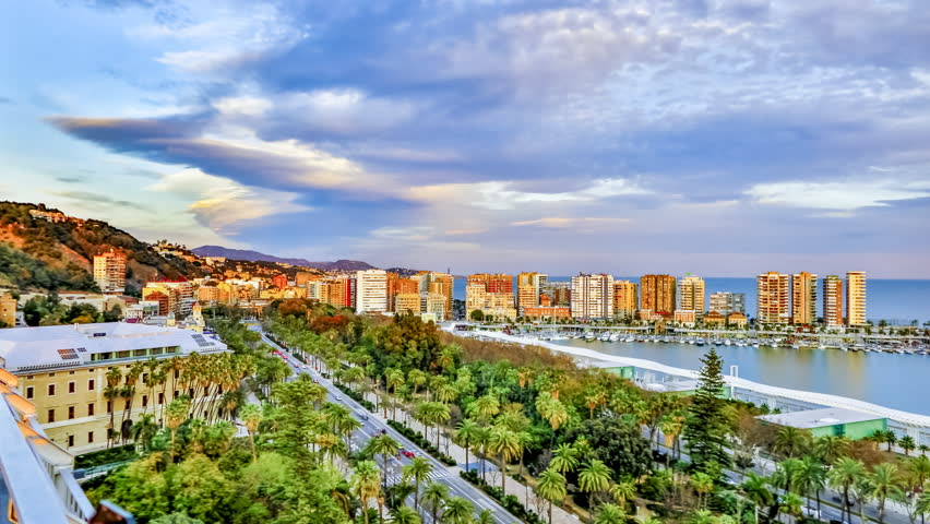 Amazing Time Lapse from the top of the hotel Malaga Palacios a espectacular sunset over the port and the city of Malaga. Andalucia Spain . | Shutterstock HD Video #1011893534