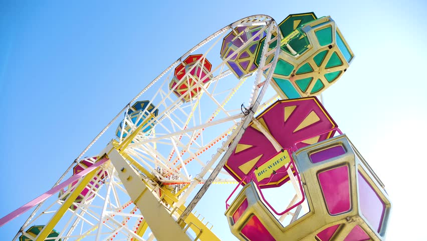 Ferris wheel on blue sky background. Video 4k | Shutterstock HD Video #1011896048
