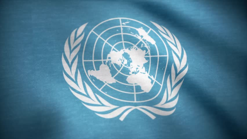 United Nations flag. The United Nations flag waving in the wind. International flag of UN