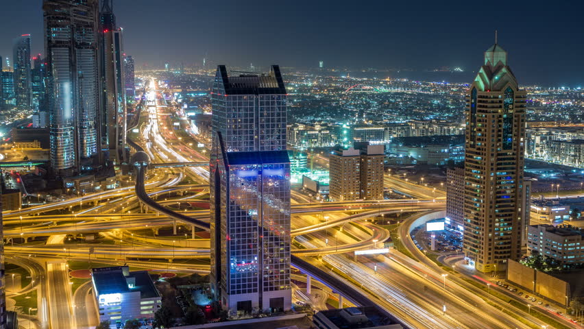 Night traffic on a busy intersection on Sheikh Zayed highway aerial timelapse. View from rooftop in Dubai downtown with modern skyscrapers | Shutterstock HD Video #1011916409