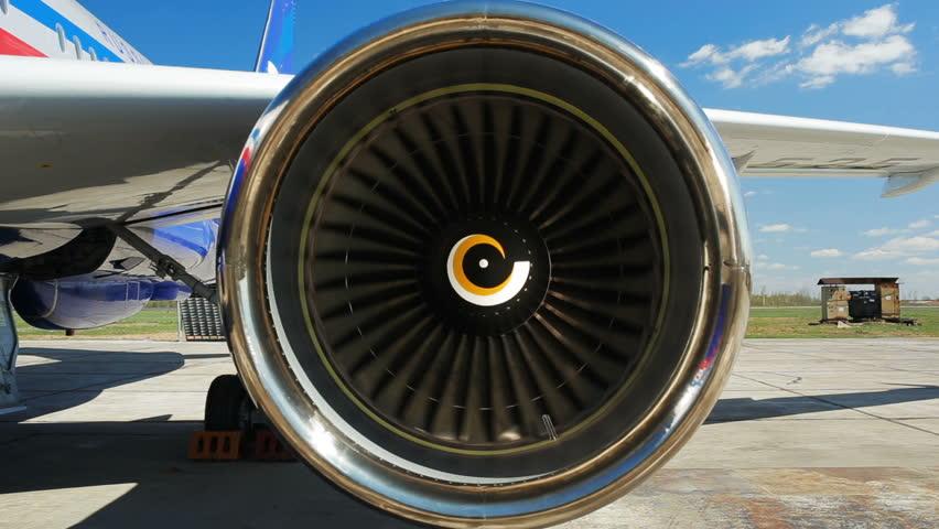 powerful jet engine starts turning against sky