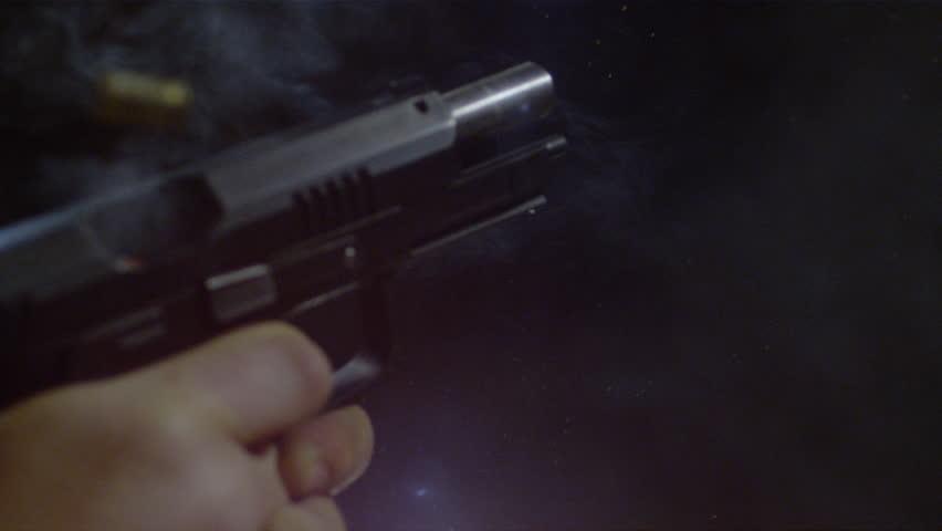 Close up of an automatic gun firing | Shutterstock HD Video #1011940358