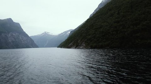 Norway. Fjords.  Cruising Fjord. Go by ship through the fjord.