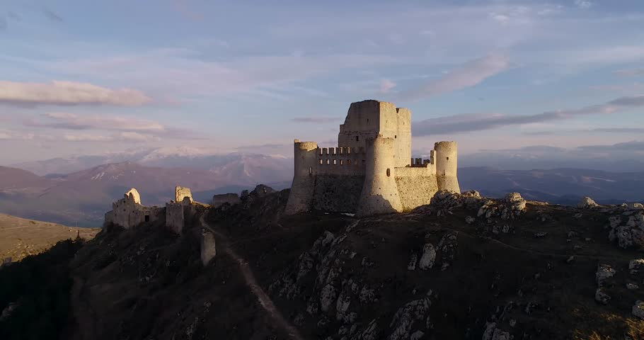 Rocca Calascio is a mountaintop fortress or rocca in the Province of L'Aquila in Abruzzo, Italy. At an elevation of 1,460 metres (4,790 ft), Rocca Calascio is the highest fortress in the Apennines | Shutterstock HD Video #1011961220