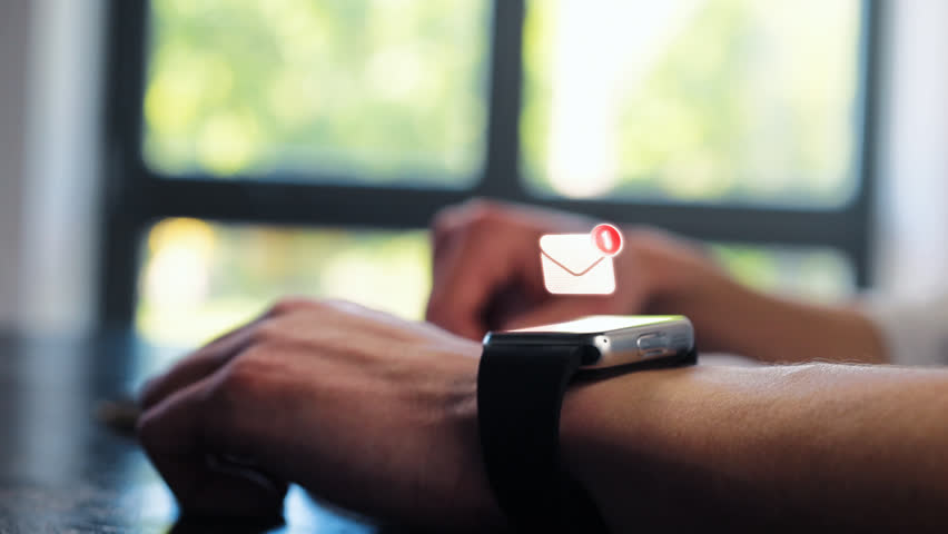 Close up of businessman hands checking incoming notification on smart watch. Animation of hologram envelope message, mail, letter, futuristic email. Future digital technology concept.