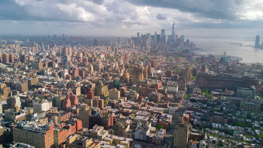 Aerial view of Manhattan, New York City. Skyscrapers around. Sunny day, aerial timelapse dronelapse. Clouds on background.