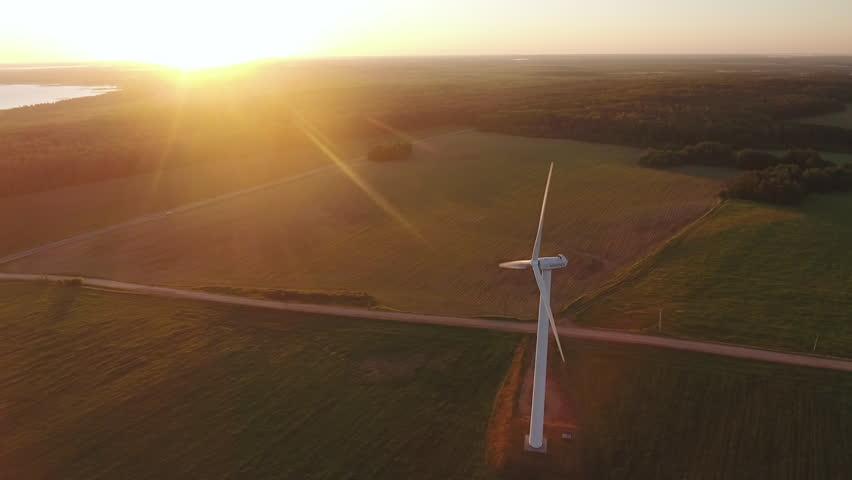 Aerial View. Beautiful windmill turbines , wind energy turbines . Aerial drone shot. | Shutterstock HD Video #1011987365
