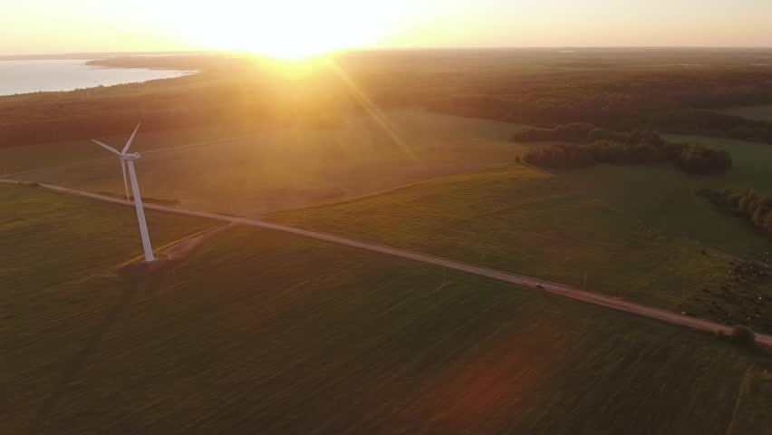 Aerial View. Beautiful windmill turbines , wind energy turbines . Aerial drone shot. | Shutterstock HD Video #1011987371