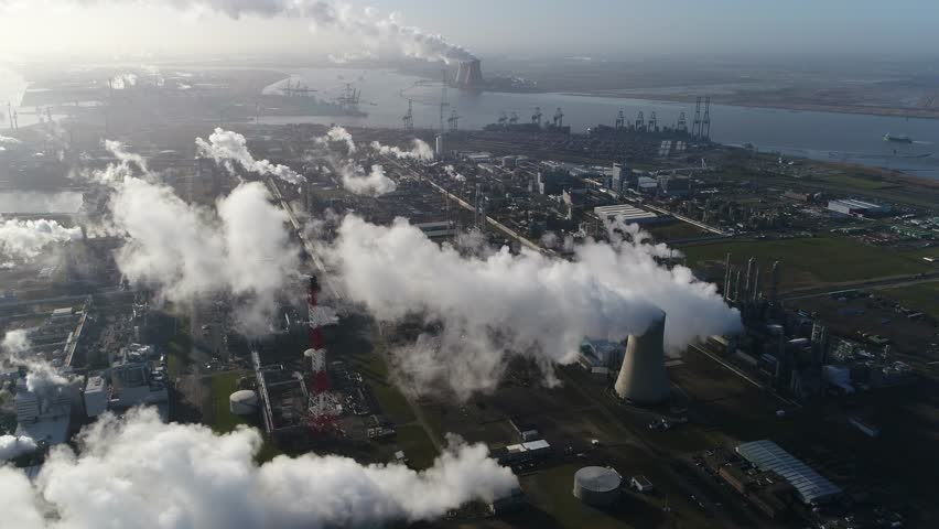 Aerial footage of nuclear power plant or nuclear power station a thermal power station in which the heat source is a nuclear reactor this plant is located in a heavy industrial zone 4k quality Royalty-Free Stock Footage #1011994187