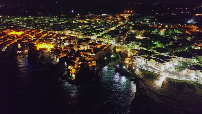 Italy coast city drone Apulia Bari night flight