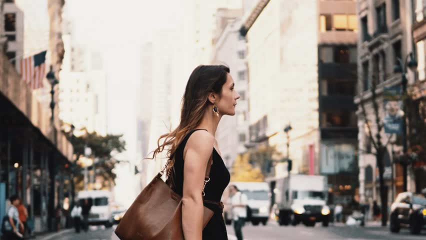 Young beautiful woman crossing the road in traffic downtown of New York, America. Female walking through the crosswalk. Royalty-Free Stock Footage #1012012190