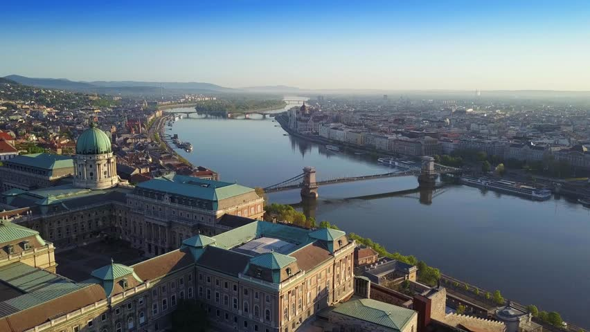 Budapest, Hungary - 4K Aerial skyline view of Budapest with Buda Castle Royal Palace, Szechenyi Chain Bridge and River Danube at sunrise | Shutterstock HD Video #1012012937