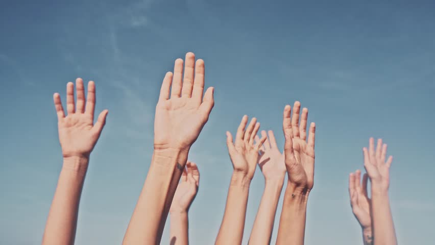 People rasing hands on blue sky background. Voting, democracy or volunteering concept Royalty-Free Stock Footage #1012015784