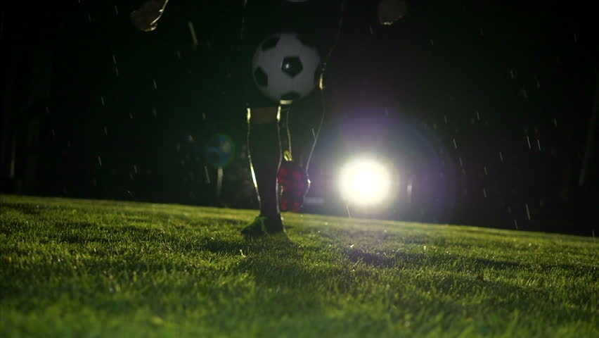 Football player praticing with soccer ball on football pitch | Shutterstock HD Video #1012021697