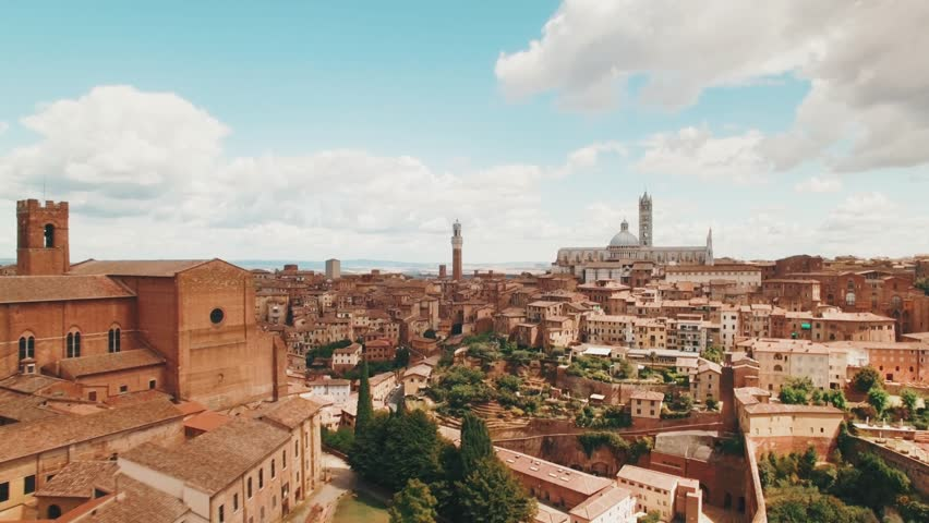 Drone: Flight over a medieval town of Siena, Tuscany, Italy