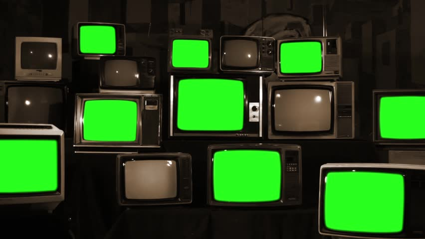 "Nine Old TVs with Green Screen and Stacks of Retro TVs. Sepia Tone. Zoom Out. You can Replace Green Screen with the Footage or Picture you Want with ""Keying"" effect in After Effects. 