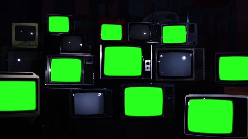 "Nine Old TV Sets Turning On Green Screen and Stacks of Retro TVs. Zoom In Slow. Night Tone. You can replace green screen with the footage or picture you want. You can do it with ""Keying"" effect. 