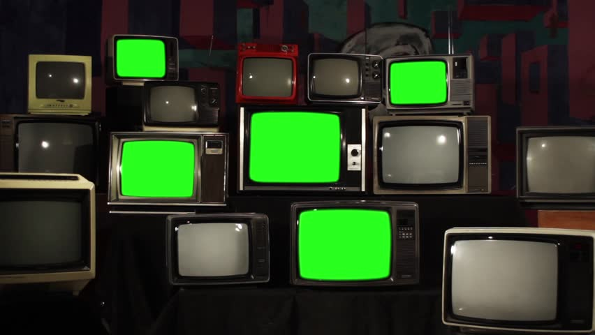 """Multiple Retro TVs turning on Green Screens. Zoom Out. You can replace green screen with the footage or picture you want. You can do it with """"Keying"""" effect in After Effects. 