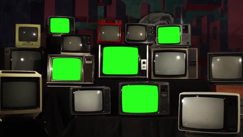 "Multiple Retro TVs turning on Green Screens. Zoom In. You can replace green screen with the footage or picture you want. You can do it with ""Keying"" effect in After Effects. 
