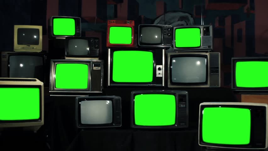 """Multiple Retro TVs turning on Green Screens. Zoom Out. Iron Tone. You can replace green screen with the footage or picture you want. You can do it with """"Keying"""" effect in After Effects.   Shutterstock HD Video #1012061852"""