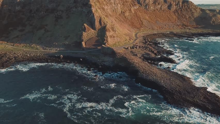4k Aerial Shot of Giant's Causeway rocks in Northern Ireland   Shutterstock HD Video #1012074530