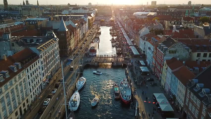 Amzing Backlight sunset footage from Copenhagen, Denmark. bridge in Nyhavn New Harbour canal and entertainment district. Aerial Video footage view from the top. forward movement. Sunset golden light | Shutterstock HD Video #1012076570