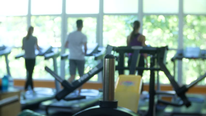 Blurred fitness gym people cardio workout in sport club center. 4k. | Shutterstock HD Video #1012090391