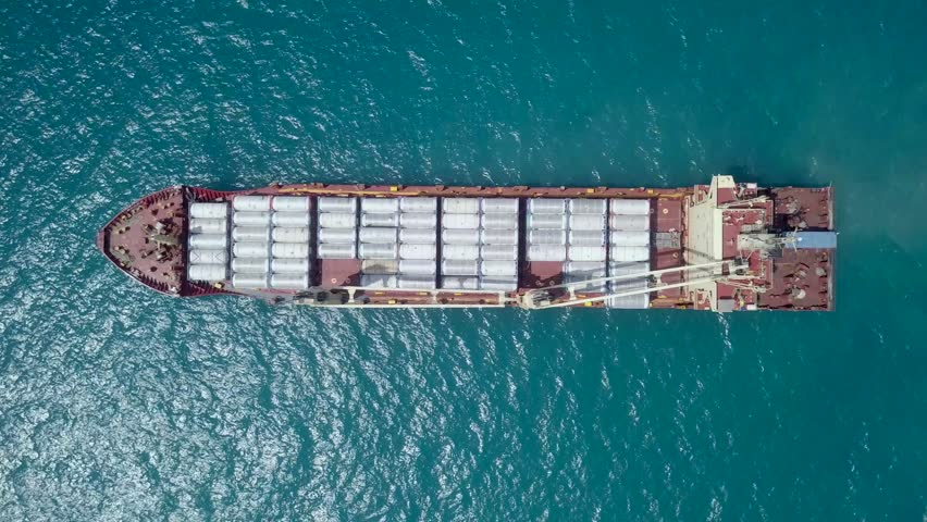 Large general cargo ship loaded with gas containers - Top down aerial footage #1012107560