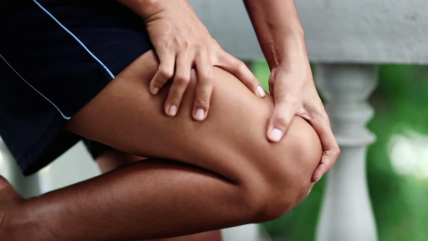 Knee pain woman she was massaging at her knee she is very painful, Health care concept.