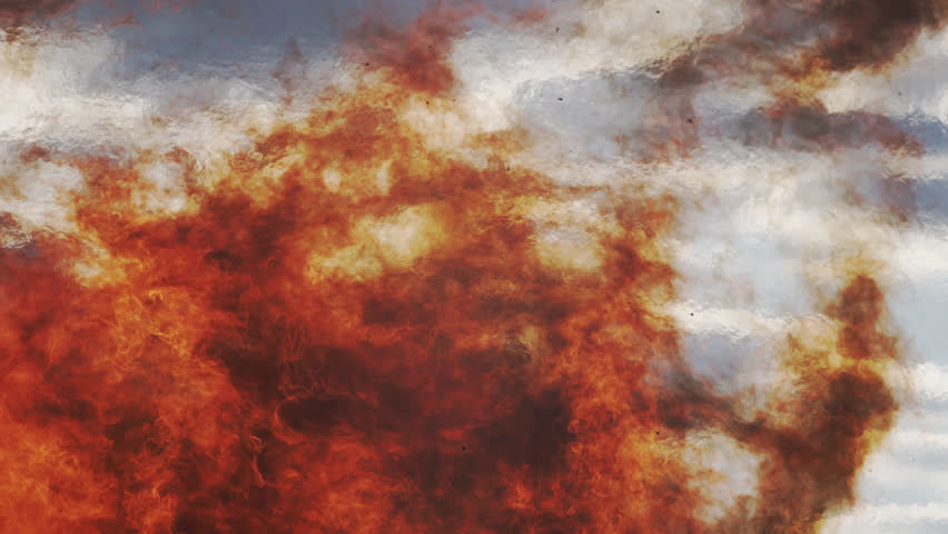 Close Up Shot Of Raging Wild Red Fire Flames Against A Cloudy Sky With Heat Haze.