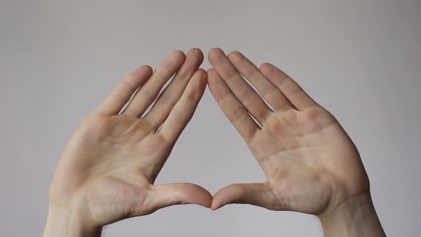 Hands Create Illuminati Triangle Symbol