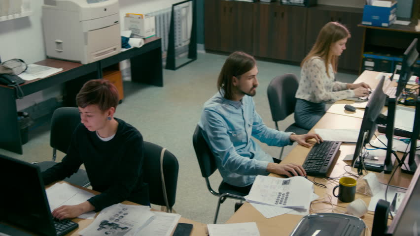 Young Employees are Working in the Open Space Office at Common Desk with Computers Royalty-Free Stock Footage #1012149926