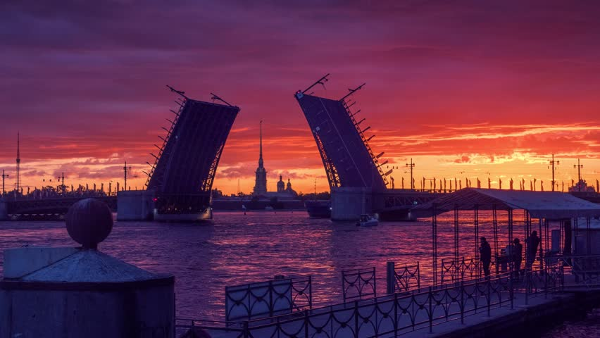 Sunrise on Neva River with Palace Bridge raised and Peter and Paul Fortress in background. Saint Petersburg, Russia. 4K UHD Timelapse.