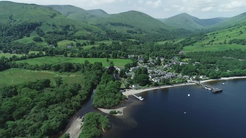 Aerial footage over the picturesque village of Luss on the banks of Loch Lomond.