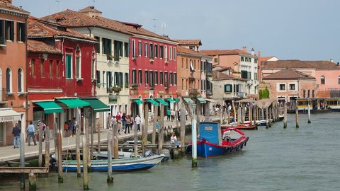 Murano, Venezia, Italy. April 30, 2018. View on canal with boats and the traditional houses
