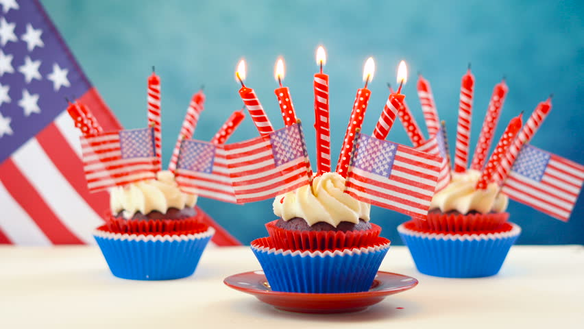 Red white and blue theme cupcakes with USA flags for Independance Day or USA theme party food. | Shutterstock HD Video #1012206296