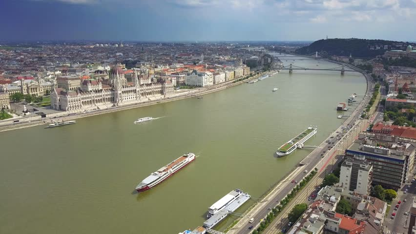 Budapest, Hungary - 4K Aerial skyline view of centre of Budapest with Hungarian Parliament, Szechenyi Chain Bridge and cruise ship on River Danube | Shutterstock HD Video #1012209437