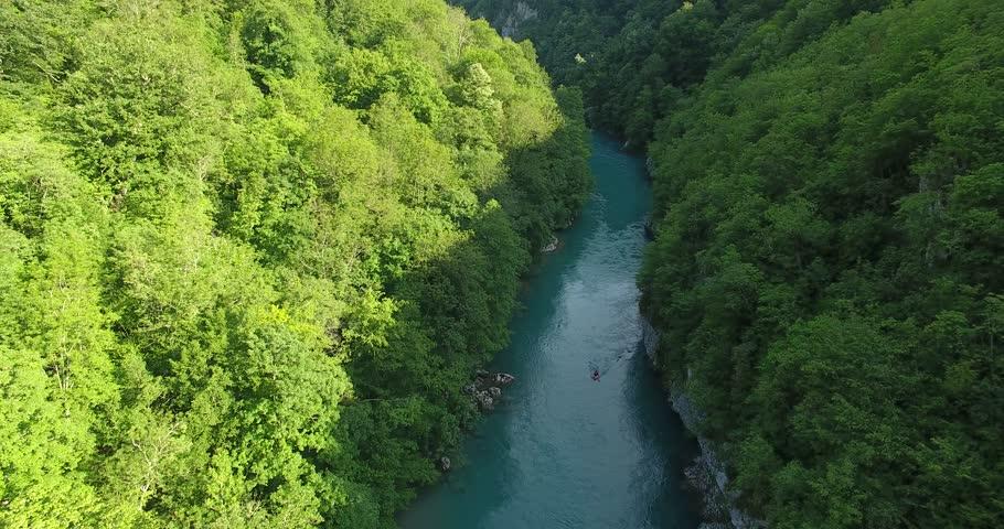 Aerial Shot of Man in Kayak on Tara River #1012210007