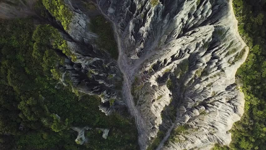 Putangirua Pinnacles, New Zealand, Aerial Top Down View, Flying Zoom Out 4k