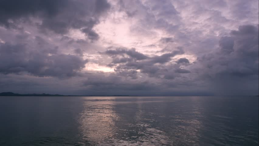 4k Time lapse sun rising and breaking through swift passing rain clouds over stormy sea. Koh Chang, Trat, Thailand. Before heavy rain storm. On the sky is covered all over by the clouds. | Shutterstock HD Video #1012217642