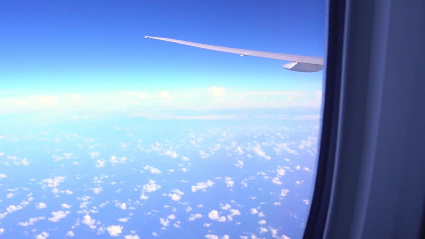View from airplane window to the sky and plane wing, nobody #1012224653
