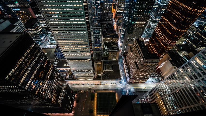 Toronto, Ontario / Canada - June 10 2018: Time lapse of the Toronto downtown modern and futuristic financial district office building skyscrapers with car traffic light streaks. | Shutterstock HD Video #1012261649