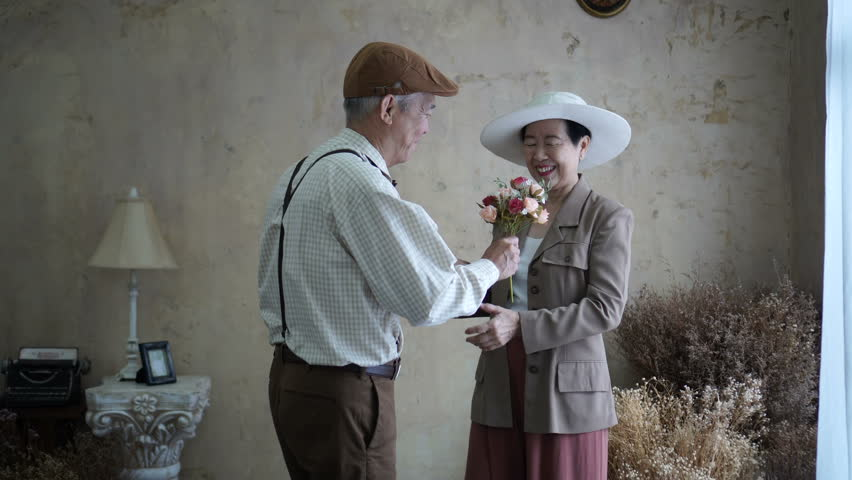 Asian senior elder couple celebrate Valentine's day flower dating love