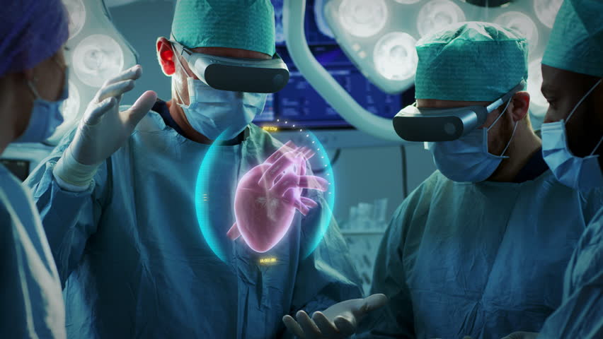 Surgeons Perform Heart Surgery Using Augmented Reality Technology. Difficult Heart Transplant Operation Using 3D Animation and Gestures. Interactive Animation Shows Vital Signs. Futuristic Hospital.