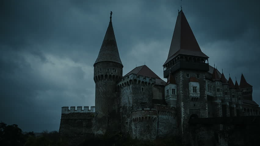 Medieval Castle at twilight with stormy clouds on background.Corvin Castle, Hunedoara, Romania   Shutterstock HD Video #1012271978
