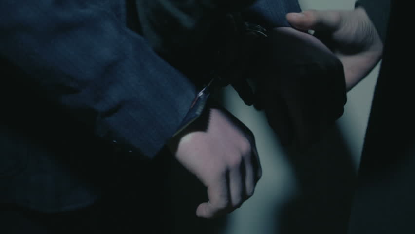 Police officer and a suspect with handcuffs.Close Up | Shutterstock HD Video #1012272131