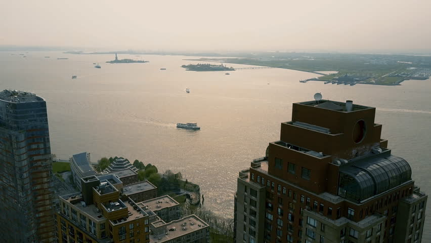 Aerial view of Lower Manhattan, financial and business district, New York City, USA. Drone shot.   Shutterstock HD Video #1012274195