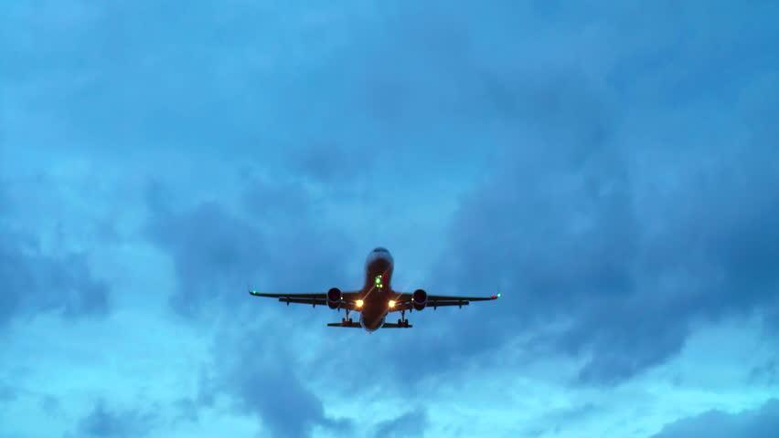 Passenger Jetliner Overhead. Sunset, Clouds.